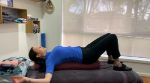 Relaxing stretch with deep breathing (using foam roller)